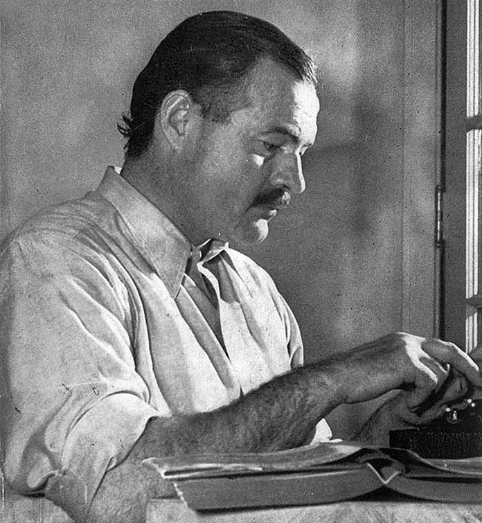 "Hemingway posing for a dust jacket photo by Lloyd Arnold for the first edition of ""For Whom the Bell Tolls"", at the Sun Valley Lodge, Idaho, late 1939"